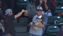 San Francisco Giants Fan Catches Foul Ball Whilst Holding Baby [Video]